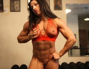Female bodybuilder and muscle porn star Ripped Vixen is posing naked for you in the gym, showing you her ripped, tattooed abs, vascular biceps, and powerful pecs, and taking off her panties and opening her muscular legs so you can see her masturbate her big clit close up.