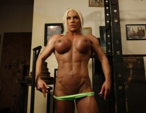 Ashlee Chambers is posing in the gym, wanting you to see every inch of her ripped, vascular muscles. Enjoy her big biceps, powerful pecs, her massive legs and calves and her awesome abs. But when she takes off her panties and plays with her pretty pussy, you're not getting any of her big clit - she'll fondle every inch of it herself.