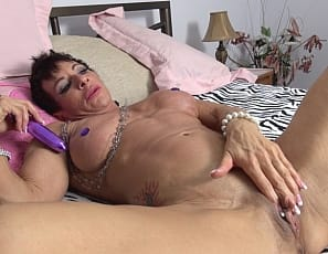 Female muscle pornstar Anna Phoenixxx gets home from her workout and lays down to rest. Once on the bed she can't help but rubs her hands all over her muscled physique getting herself all worked up. She breaks out her favorite sex toys and gives her big clit and wet pussy nice hard workouts of their own.