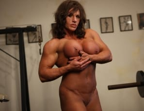 Laurie, a female muscle favorite, loves working out her big biceps, tight abs, and powerful legs in the gym. In fact, she really gets off on it - it makes her feel powerful and sexy. So much so that she can't help herself and pulls off her panties and begins giving her big clit a workout as well. Who's going to complain? Not us!