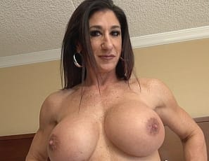 Female bodybuilder and muscle porn star Hot Italian is posing in the bedroom, showing off her vascular biceps, ripped abs, powerful pecs and legs, and muscle control. She wants to get her pretty kitty going while she waits for her date, so she takes off her panties and masturbates her big clit and lets you watch in close-up.