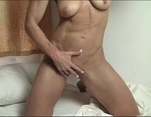 Female muscle porn star Audrey doesn't want the camera in the bedroom, but she decides to pose for you anyway, showing off her muscular pecs, biceps, and abs, and taking off her panties so she can masturbate her big clit while you watch in close-up.