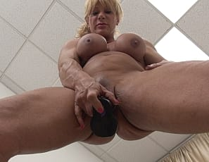 WildKat has a big clit. She loves showing it off and having it - along with her big pecs, massive biceps, and strong quads - admired and worshiped. WildKat also loves to break out a sex toy and masturbate until her clit is bulging and her pussy is soaking wet. And we love to watch it all!