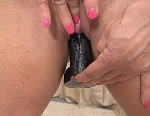 Mature female muscle porn star WildKat loves her big clit - we already knew that - but she also enjoys fucking herself deep and long with her favorite sex toy. Powered by her huge biceps, WildKat plunges her dildo deep into her pussy over and over again and we get the pleasure of watching. WildKat really does have it all: biceps, abs, big quads, and powerful legs.