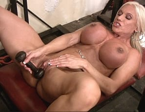 Female bodybuilder, fem domme and muscle porn star Ashlee Chambers is in the Gym, working her vascular .  Then she grabs a dumbbell to penetrate her wet pussy and feel the cold iron on her big clit. You get to watch in close-up.
