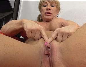 Female bodybuilder	Wild Kat is superheroine SuperClitty, ready to make the world a better place, by posing for you to show off the vascular muscles of her pecs, biceps,legs, and abs, then taking off her superpanties for some clit pumping, making her big clit even bigger. Watch her masturbate and penetrate herself in close-up.