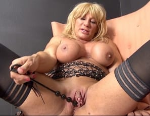 Female bodybuilder  and muscle porn  star WildKat, posing in stockings, masturbates her big clit, then penetrates herself with a toy while you enjoy the mature muscles of her pecs,  biceps, abs and legs.