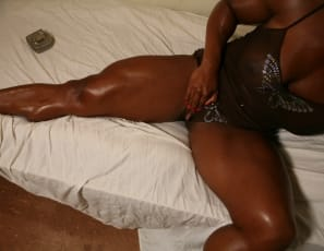 In her room, ebony female bodybuilder Carmella poses to show you just how impressively big she is. Everywhere! Those muscular ebony legs and calves are looking good, and her big clit is obviously getting lots of workouts to stay that big and hard.