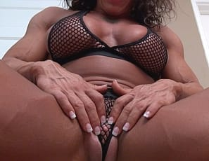 I'm bossed around by my big clit,  says tattooed female bodybuilder and muscle porn star MuscleFoxx. It makes it difficult to wear panties to pose or work out and to keep the ripped, vascular muscles of her biceps, pecs, legs, and abs strong. She has to clit-pump it and masturbate it to keep it happy. There's good news, though. You get to watch it all in close-up.