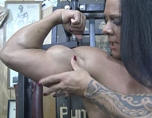 You're at the gym in your virtual session with naked, tattooed female bodybuilder Goddess of Iron as she shows you how she works her biceps and pecs with muscle control and poses for you to show off the mature muscles of her  abs, glutes, and legs. She can't help masturbating her big clit and showing you her ass. Watch it in close-up.
