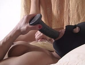 Female muscle porn star Slave Lauren is in the bedroom with her muscular legs spread wide, masturbating her big clit and penetrating her wet pussy with a toy as you enjoy watching her glutes, pecs, and ass in close-up.