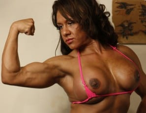 Female bodybuilder Rica is posing in the gym, and her pecs and biceps muscles are looking big. So are her glutes and legs, when she turns around to play with her ass. But when she starts masturbating her big clit, you'll realize it's getting even bigger. And that's not just the close-up.