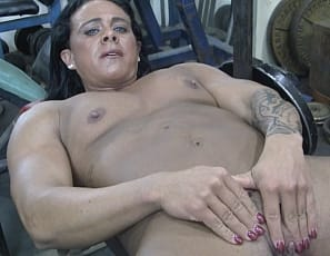 Tattooed female bodybuilder Goddess of Iron likes to spread her legs while she bench presses naked in the gym so she can feel the air on her big clit.  Watch in close-up as she poses and masturbates, and enjoy the mature muscles of her powerful pecs, ripped abs, vascular biceps, strong glutes and legs, and her muscle control.