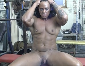 In your virtual session in the gym with female bodybuilder Goddess of Iron, you forgot to put more weight on for her bench press, so she'll have to do it herself. I'm ready for you, she says as she masturbates her big clit and lets you watch in close-up as she poses, and enjoy the mature muscles of her ripped, tattooed abs, big, vascular biceps, muscular glutes and legs, and her muscle control of her pecs. But you can't give her what she wants, so she'll have to do that herself too.