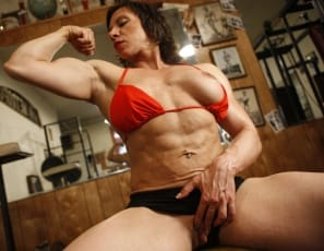 Bodybuilder Alexis gets in a good workout and some posing at the gym. But soon,instead of working her legs, biceps and abs, she's working her big clit really hard, for multiple reps, masturbating until it gets even bigger.  You see it all close up.