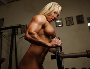 Bodybuilder Darkside Milinda has it all: strong biceps and legs, sexy pecs and glutes, super-ripped abs, a badass tattoo and attitude… and a really big clit, which she's playing with in the gym naked and showing you close-up. You won't want to miss an inch of it.