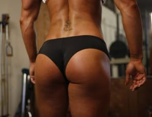 Bodybuilder Darkside Milinda, with super-ripped abs, is posing nude in the gym. Her pecs biceps and legs are super-strong, her glutes are super-tight, her tattoo is super-bad, and when you see her big clit close up, you'll want to call it Superclit.