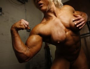 When you look at Lisa Cross, her shiny blue bikini might get your attention, or her blue-eyed gaze.  But we're betting that the results of her intense bodybuilding regimen are what you'll be focused on as she poses naked in the gym: the massive biceps and legs, the vascular pecs, the sexy glutes.