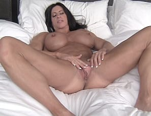 Female bodybuilder and muscle porn star Angela Salvagno loves it when people look at her muscles. Naked in her bedroom after a day at the beach, she's posing to show off her vascular biceps, ripped abs, and powerful pecs, legs and glutes, then masturbating her big clit and juicy pussy while you watch.