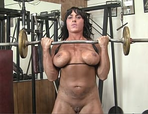 Tattooed female bodybuilder Whitney's panties say University of Pink, and she shows you why in the gym, masturbating her wet pussy and big clit after posing to show you her muscular pecs, biceps, legs and glutes. You get to see the pink in close-up.   When I work out, I get turned on, she says. And so will you.