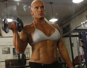 You've got a date with a platinum blonde with a six-pack! Bodybuilder Nicole Savage shows off her impressive vascularity and musculature as she works out and poses in the gym. Ever seen naked flys before? How about a lovely [pierced] big clit, close up? You will now.