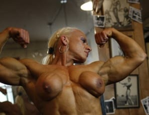 Nicole Savage is resting her hard-muscled body in the gym, touching her big pierced clit and showing off her ripped abs, strong legs and vascularity. But look at her feet – they've gotten so dirty! Can someone volunteer to help her clean them?