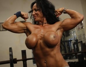 Bodybuilder Rhonda Lee Quaresma poses in the gym, showing you those big biceps, then unzips her leotard so she can reach in. Then she peels it and her fishnet tights off. She's nude so you can admire her glutes, legs, and big clit from the front and back, and lies on a bench, barefoot, to masturbate. Lucky you, you see it in close-up.