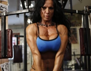 Pro Bodybuilder Rhonda Lee Quaresma doesn't waste much time before she shows you her big clit as she poses in the gym. She knows how much you want to see it, and the tattoo that accentuates her rock-hard abs shows you the way, while she touches her clit so you can see how pink and wet it is in close-up. Looks good from behind, too, with those gorgeous glutes and big quads framing it.