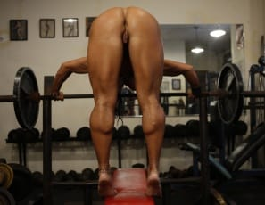 Naked in the gym, bodybuilder Rhonda Lee Quaresma bends over the bench to give you a look at her great glutes and muscular legs and calves, and a close-up view of her pretty pussy.  Then she turns around and poses to show off her big biceps and pecs and the blue tattoo that leads right to her big clit.