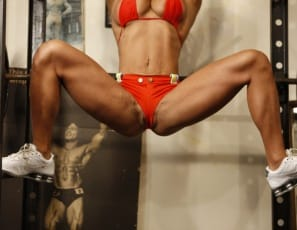 Bodybuilder Rica's at the gym, posing nude and showing off her sexy pecs, legs and glutes and flexing her big biceps. Then she bends over for a close-up of her ass and her big clit. She's in red – and she's ready. Are you?
