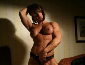 Bodybuilder Roxie Rain's in the bedroom and she can't keep her hands off her beautiful muscular body – all that definition and vascularity! And once her hands find her big clit, she can't stop masturbating. But wouldn't you want to touch her – if she'd let you?
