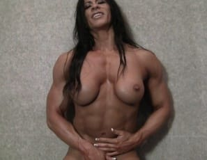 """I have a big pussy. I need a big cock,"" says naked female bodybuilder Angela Salvagno, posing and flexing her muscular pecs and biceps and ripped abs as she masturbates her pussy and big clit standing up in the bedroom, then turning around to show you her legs and glutes and playing with her ass. ""You couldn't handle me,"" she taunts. Could you?"