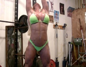 Bodybuilder Ashlee Chambers likes to stretch naked before she works out in the gym, and being flexible is an asset for her work as a porn star. Watch her as she stretches and poses barefoot with her legs wide open and behind her head, giving you close-up views of her lovely pussy and big clit – not to mention her gorgeous glutes, tight abs and vascular biceps.