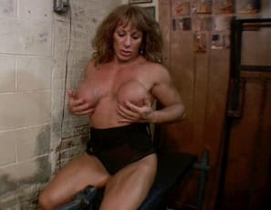 At the gym, bodybuilder Wild Kat poses and does leg extensions, squeezing out every last rep, then takes a pleasure break naked, so you can see her sexy pecs, glutes, calves and biceps as she masturbates her big clit in close-up to squeeze out every last moan. Can you squeeze one out too?